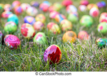 Colorful Easter egg in the grass
