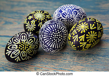 Colorful easter egg on wood background.