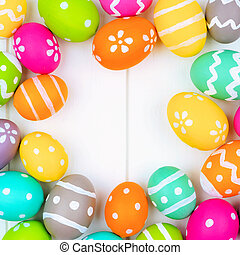 Colorful Easter Egg square frame over a white wood background