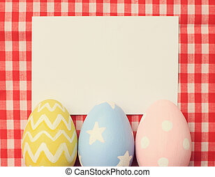 Colorful easter eggs and blank note paper with retro filter effe