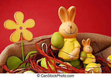 Colorful Easter eggs and two bunnies with a flower