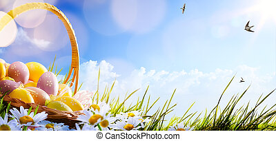 Colorful Easter eggs decorated with flowers in the grass on blue