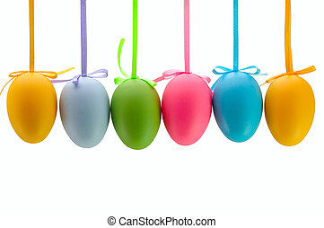 Easter eggs hanging on ribbons. Isolated.