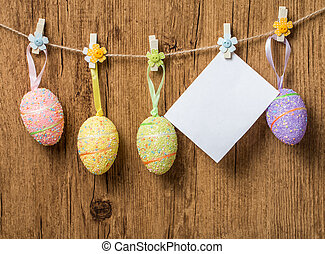 Colorful Easter eggs hanging on ribbons