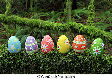 Easter eggs - Colorful Easter eggs in a mossy forest.