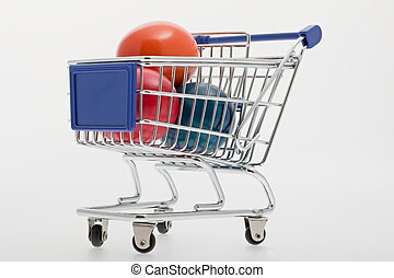 Colorful Easter eggs in a shopping trolley in front of white...