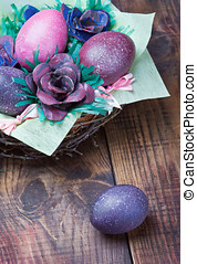 Colorful easter eggs in brown a basket
