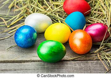 Colorful easter eggs in brown basket