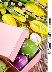 Colorful Easter eggs in gift box