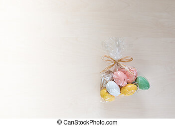 Easter eggs in present on wooden background.