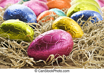 Colorful easter eggs in straw