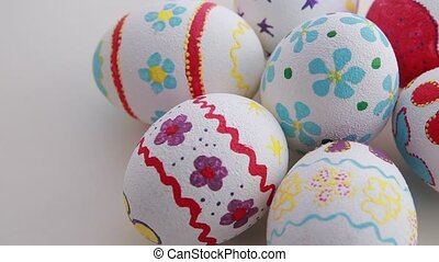 Colorful easter eggs isolated over white background. Close...