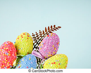 Colorful Easter Eggs on a blue background.