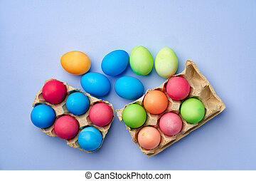 Colorful Easter eggs on blue background top view