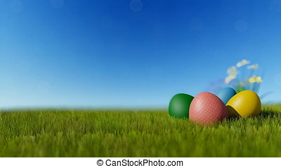 Colorful Easter eggs on green meadow over blue sky