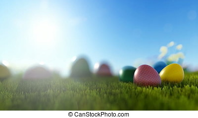 Colorful Easter eggs on green meadow over bright sun