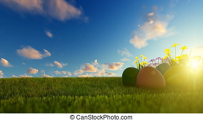 Colorful Easter eggs on green meadow over beautiful sunset