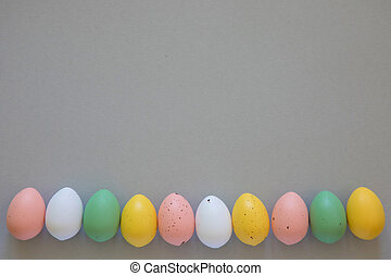 Colorful easter eggs on grey background