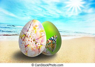 Colorful easter eggs on sunny beach