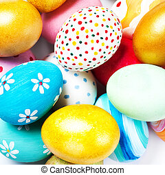 Colorful Easter Eggs on white with copy space.