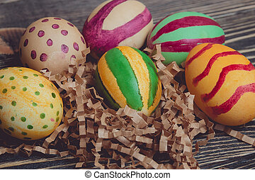 Colorful Easter Eggs on Wood Board Background