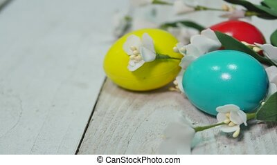 Colorful Easter eggs on wooden background/ Easter holidays background.