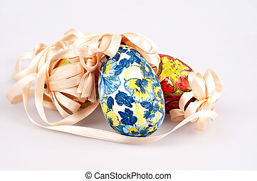 colorful easter eggs with ribbon