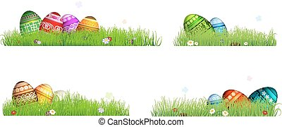 Easter eggs with spring flowers in the grass