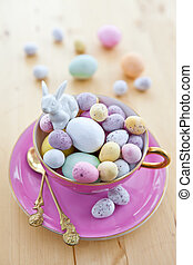 Colorful eggs for a happy easter in a vintage pink cup