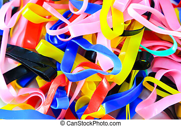 colorful elastic rubber bands on white texture background