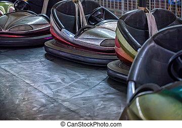 Colorful electric bumper cars in autodrome - Close up...