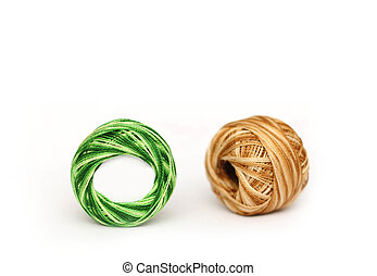 Colorful embroidery threads isolated on white