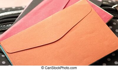 colorful envelope on pink background with copy space