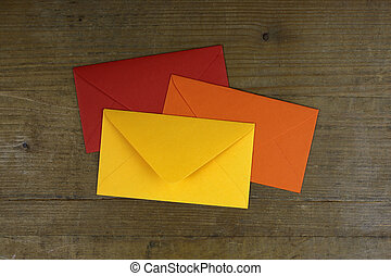 colorful envelopes on wooden background