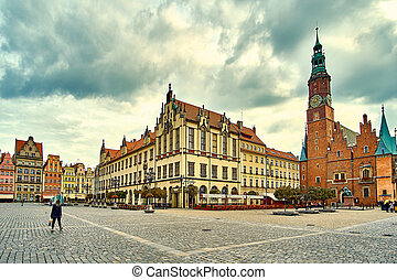 Colorful evening scene on Wroclaw Market Square with Town Hall. Sunset in historical capital of Silesia, Poland, Europe. Artistic style post processed photo.