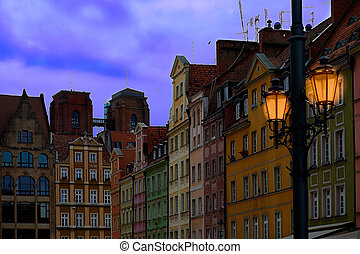 Colorful evening scene on Wroclaw Market Square with vintage streen lanterns. Sunset in historical capital of Silesia, Poland, Europe. Artistic style post processed photo.