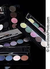 Colorful Eyeshadow Collections on Black Background