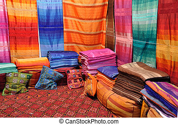 Colorful fabrics and cushions for sale in Fes, Morocco