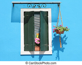 colorful facade with window with shutters