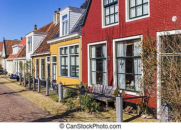 Colorful facades of old houses in Harlingen, Netherlands
