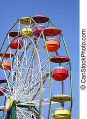 Colorful ferris wheel with blue sky background