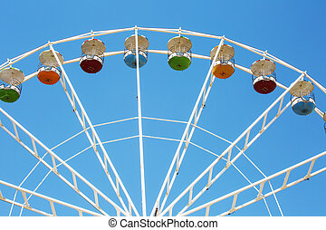 Colorful ferris wheel on blue sky background in Luna Park.
