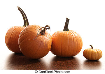 Colorful festive pumpkins on wood table against white