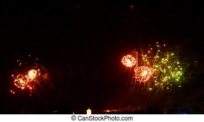 Colorful fireworks at holiday night background