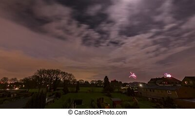 Colorful fireworks at in the suburbs of Germany - time lapse...