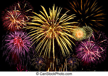 Colorful fireworks celebration on dark background.
