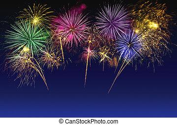 Colorful fireworks celebration on the twilight sky.