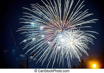 Colorful fireworks on background night sky. The explosions of salute from pyrotechnics at festival
