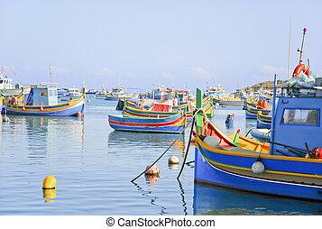 Colourful fishing boats at marina at Malta a mediterranean island