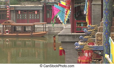 Colorful flags, lanterns, gargoyles and ferry boat on the...